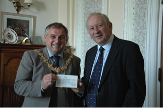 Roy Cartlidge presenting cheque to Chris Godbold